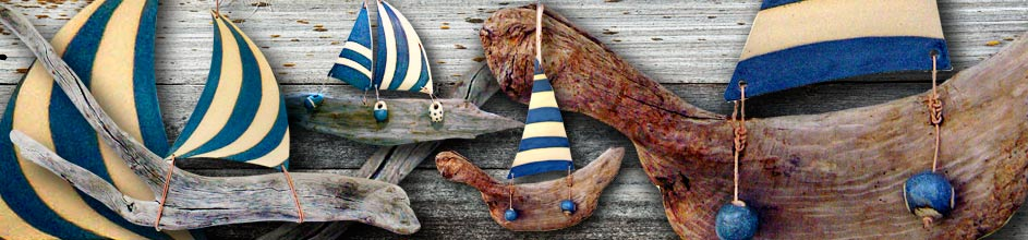 Jan Guest coastal art - Ceramic and driftwood boats